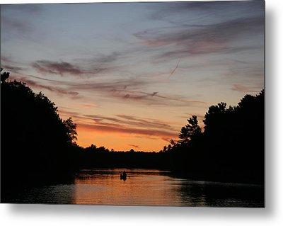 Sunset Canoe Metal Print by Ty Helbach