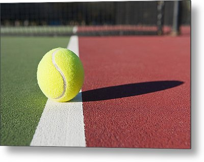 Tennis Ball Sitting On Court Metal Print by Thom Gourley/Flatbread Images, LLC