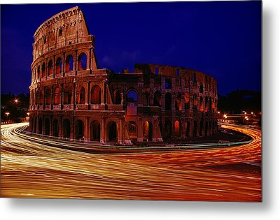 Traffic Races Around The Ruins Metal Print by Winfield Parks