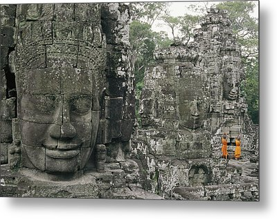 Two Monks In Orange Robes Stand Metal Print by Paul Chesley
