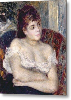 Woman In An Armchair Metal Print by Pierre Auguste Renoir