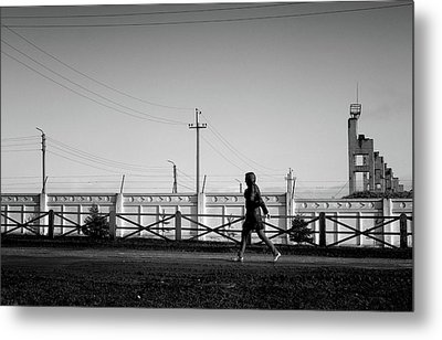 Metal Print featuring the photograph Woman Walking In Industry by John Williams