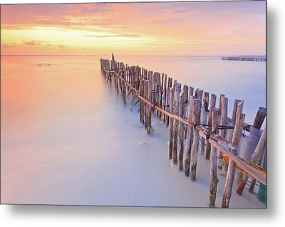 Wooden Posts Into  Sea Metal Print by Enzo Figueres