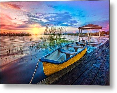Yellow Canoe Metal Print by Debra and Dave Vanderlaan