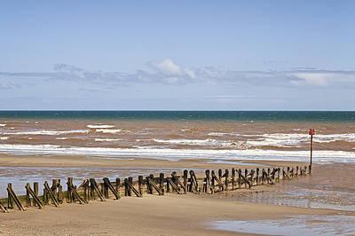 Pilings On Beach Poster by Jon Boyes