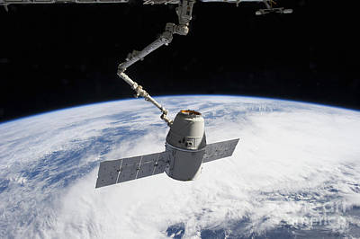 Fantasy Royalty-Free and Rights-Managed Images - Spacex Dragon In The Grasp Of Canadarm2 by Stocktrek Images