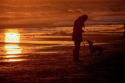 Woman And Dog  On The Beach  At Sunset Art Print