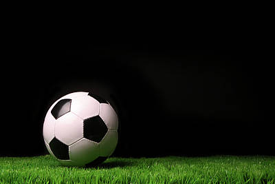 Black Stand Photograph - Soccer Ball On Grass Against Black by Sandra Cunningham
