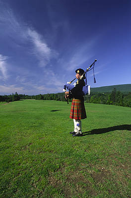 A Bagpiper At A Gaelic Mod Held Art Print by Michael Melford