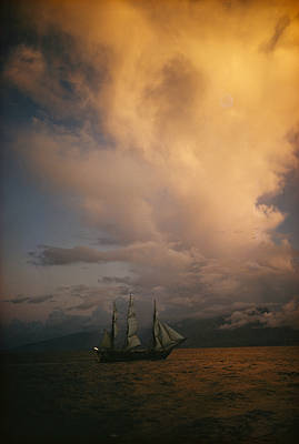 A Tall Ship, Sails Full Of Wind, Passes Print by Luis Marden
