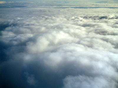 Photograph - Clouds From The Plane Iv by Emiliano Giardini