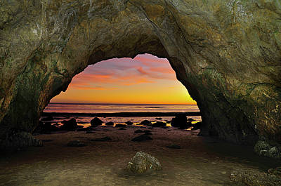 Dramatic Sunset Seen From Inside Cave On Beach Art Print