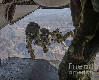 C-2 Greyhound Photograph - Sailors Jump Out Of A C2-a Greyhound by Stocktrek Images