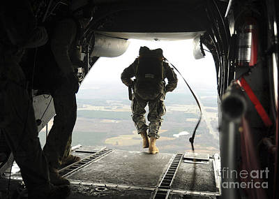 Fantasy Royalty-Free and Rights-Managed Images - U.s. Navy Seals Jump From A Ch-46e Sea by Stocktrek Images