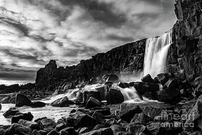 Abstract Male Faces - The famous Oxararfoss in Icelands Thingvellir National Park. by Jamie Pham