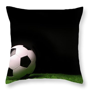 Soccer Ball On Grass Against Black Throw Pillow