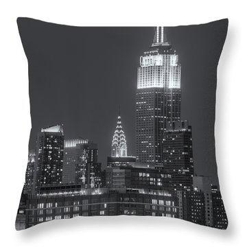 Empire State And Chrysler Buildings At Twilight II Throw Pillow by Clarence Holmes