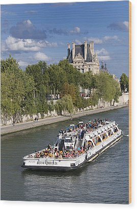 Sightseeing Boat On River Seine To Louvre Museum. Paris Wood Print by Bernard Jaubert