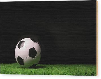 Soccer Ball On Grass Against Black Wood Print by Sandra Cunningham