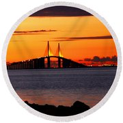 Sunset Over The Skyway Bridge Round Beach Towel