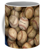 One Clean Baseball Sitting In A Pile Coffee Mug by Phil Schermeister