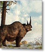 A Woolly Rhinoceros Trudges Metal Print by Daniel Eskridge