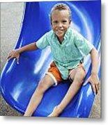 Boy On Slide Metal Print by Kicka Witte