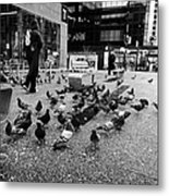flocks of pigeons on the street outside Vancouver city centre station on granville street BC Canada Metal Print by Joe Fox