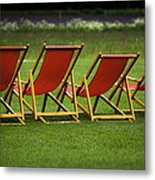 Red Deck Chairs On The Green Lawn Metal Print