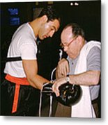 Rocky Marciano Looking At Glove Metal Print by Retro Images Archive