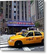 Yellow Cabs Pass In Front Of Radio City Music Hall Metal Print