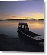 A Boat Sits On The Calm Yukon River Metal Print by Michael Melford