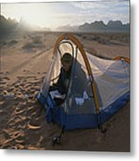 A Camper Reading In Her Tent Metal Print by Gordon Wiltsie