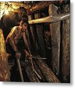 A Miner Works His Way Through A Jumble Metal Print by Randy Olson