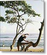 A Woman Stretches On A Beach Metal Print by Skip Brown
