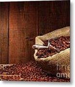 Burlap Sack Of Coffee Beans Against Dark Wood Metal Print by Sandra Cunningham