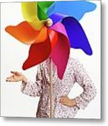 Girl Behind A Colorful Windmill Metal Print by Sami Sarkis