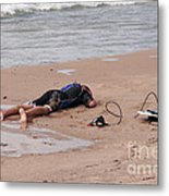 Small Surfer Lying On Beach Metal Print by Christopher Purcell