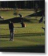 Two People Play Golf While Elk Graze Metal Print