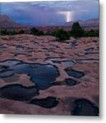 Water Puddled In The Esplanade, A Rock Metal Print by Michael Nichols
