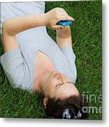 Woman Using Her Iphone Metal Print