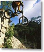 Man Jumping On His Mountain Bike Metal Print