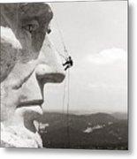 Scaling Mount Rushmore Metal Print by Granger