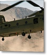 A Ch-47 Chinook Helicopter Kicks Metal Print