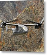 A Cv-22 Osprey Flies Over The Canyons Metal Print