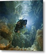 A Diver Ascends A Deep Shaft In Dans Metal Print by Wes C. Skiles
