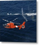 A Helicopter Crew Trains Off The Coast Metal Print by Stocktrek Images