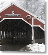 A Traditional Covered Bridge On A Snowy Metal Print