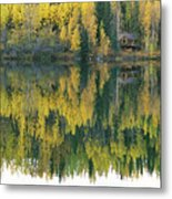 An Autumn View Of A Cabin Reflected Metal Print