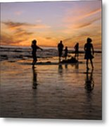 Children Playing On The Beach At Sunset Metal Print